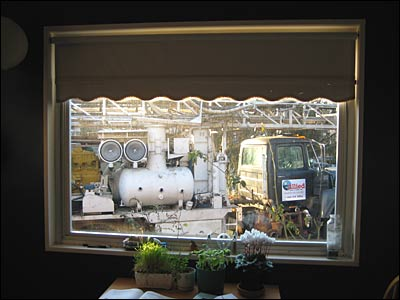 Drilling truck as seen from inside house.